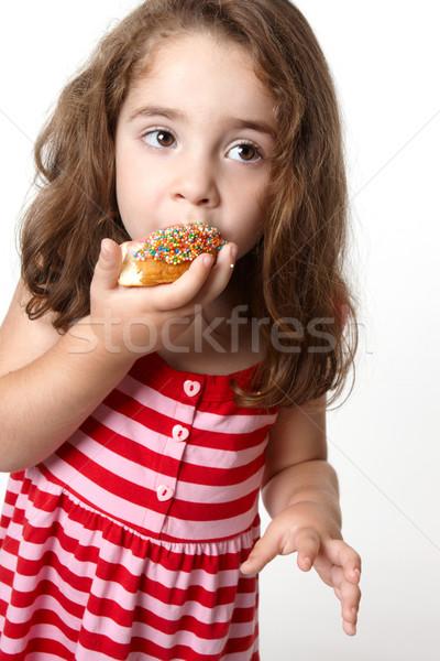 Pretty little girl eating a doughnut Stock photo © lovleah