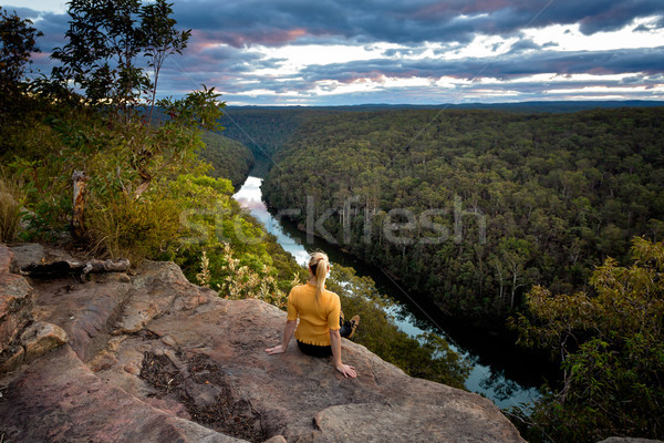 Female enjoying river views from cliff top Stock photo © lovleah