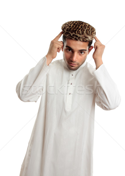 Ethnic man in robe and hat Stock photo © lovleah