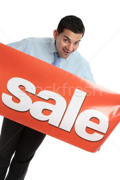 Happy businesman or saleman with sale sign Stock photo © lovleah