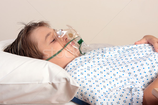 Unwell child oxygen mask Stock photo © lovleah