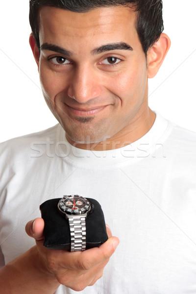Férfi tart stopperóra karóra mosolyog fém Stock fotó © lovleah