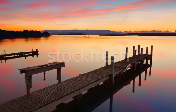 Lovely old timber jetty at sunrise Stock photo © lovleah