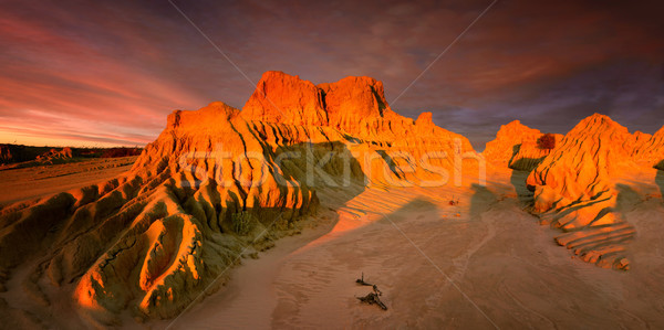 Setting sun over Red Top in Australian outback Stock photo © lovleah