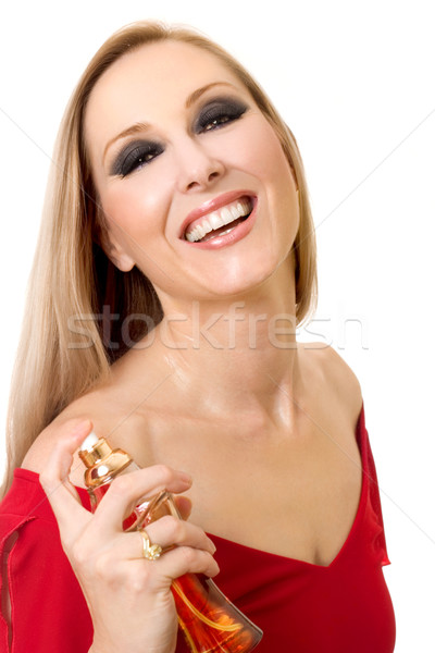 Beautiful smiling woman with bottle of perfume Stock photo © lovleah