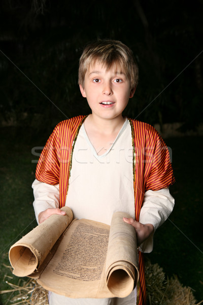 Stock photo: Boy reading a scroll