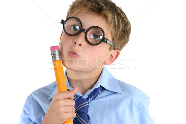 Comical boy holding a pencil and thinking Stock photo © lovleah