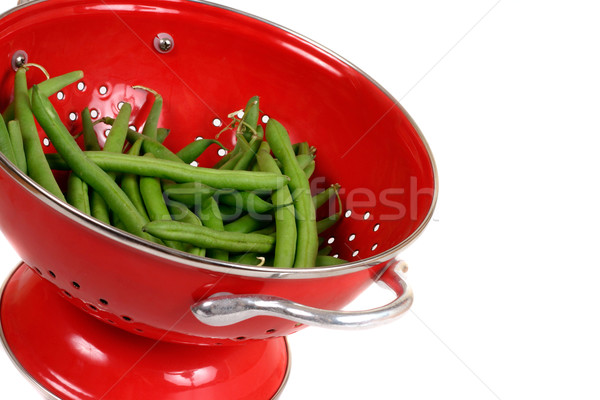 Green beans in a red colander Stock photo © lovleah