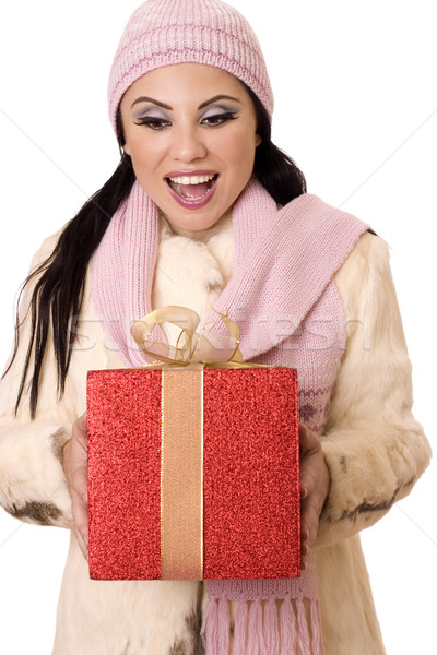 Delightful Surprise - Female holding a large red and gold gift Stock photo © lovleah