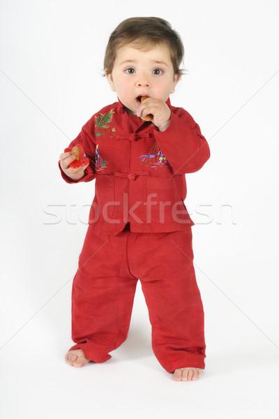 Standing baby eating TEETHING rusk Stock photo © lovleah
