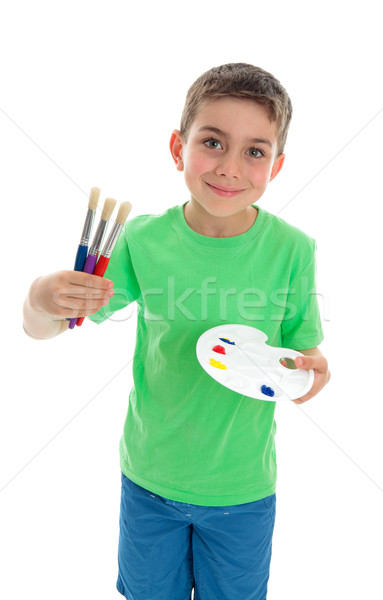 Boy with paintbrushes and artist palette Stock photo © lovleah