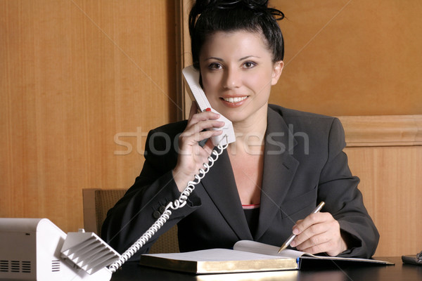 Beautiful female executive on the phone Stock photo © lovleah