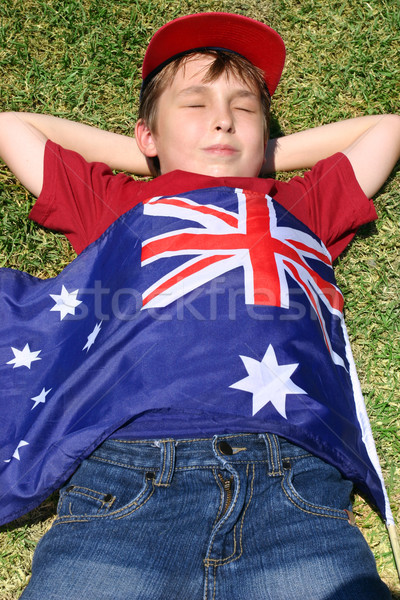 Patriotic boy with Australian flag draped over him Stock photo © lovleah