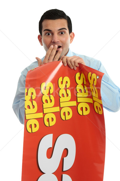 Retail shopkeeper with sale sign,  Stock photo © lovleah