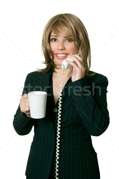 Working woman with coffee answers a phone Stock photo © lovleah
