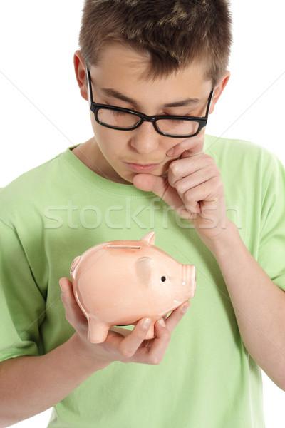 Bo thinking  with money box - savings,  finances Stock photo © lovleah