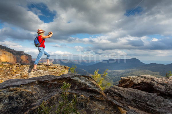 Tourist taking photos of stunning Blue Mountain vistas Stock photo © lovleah