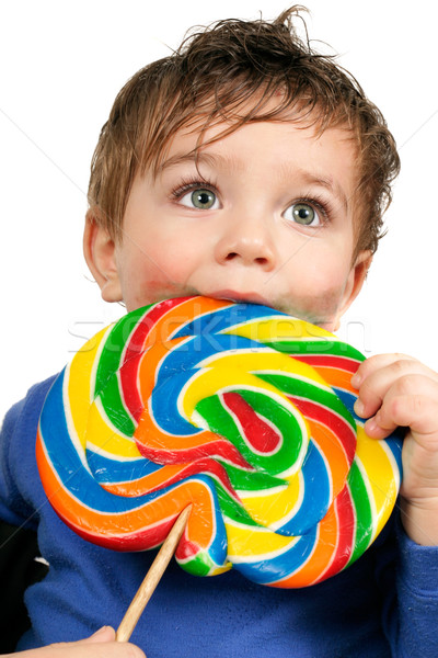 Boy eating a large  lollipop Stock photo © lovleah