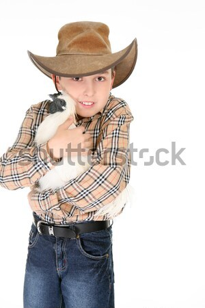 Young cowboy on white background Stock photo © lovleah