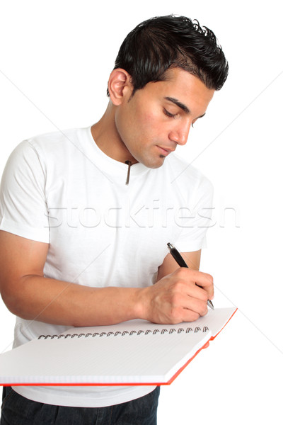 Stock photo: Man or student writes in a notebook