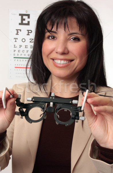 Optometrist holding trial frames Stock photo © lovleah