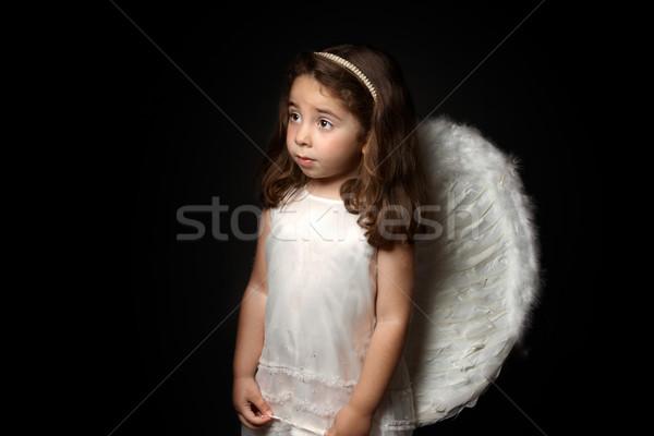 Joli peu ange regarder angélique petite fille Photo stock © lovleah