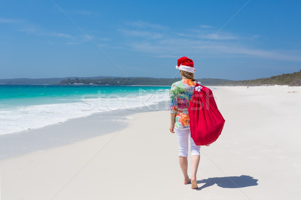 Christmas in Australia - woman walking along beach with festive  Stock photo © lovleah