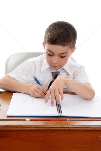 Studious boy doing school work Stock photo © lovleah