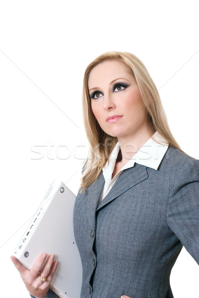 Confident businesswoman carrying computer laptop Stock photo © lovleah