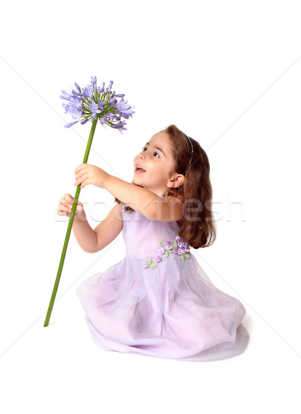 Little girl spinning a large stemmed flower with delight Stock photo © lovleah