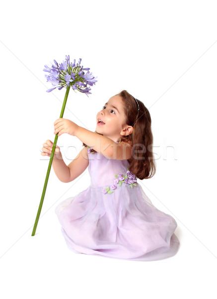 Dziewczynka kwiat radość posiedzenia piętrze Zdjęcia stock © lovleah