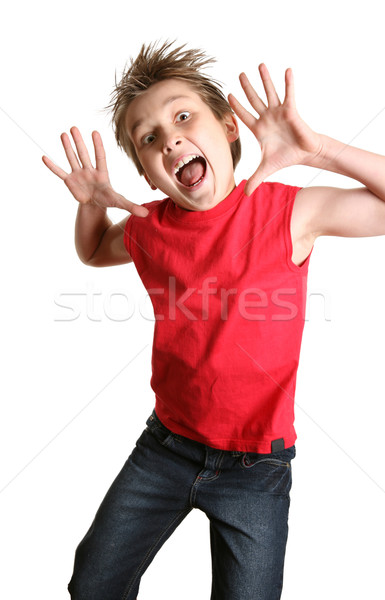 Crazy Face boy child jumping Stock photo © lovleah