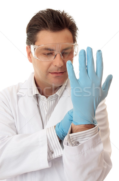 Doctor or scientist putting on nitrile safety gloves Stock photo © lovleah