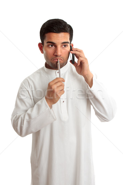 Worried ethnic man on phone Stock photo © lovleah