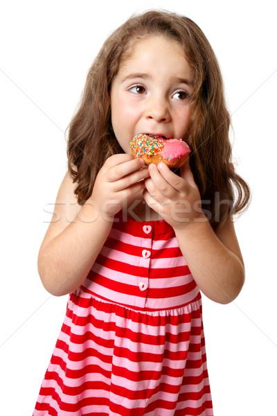 Young girl eating doughnut Stock photo © lovleah