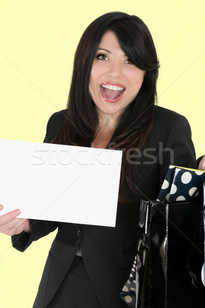 Exciter shopper woman holding a sign Stock photo © lovleah