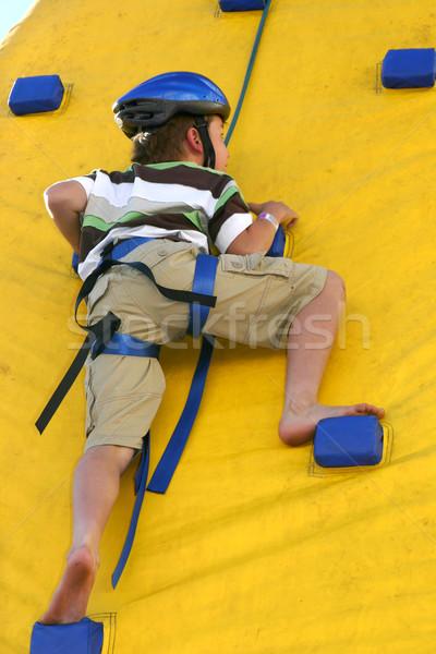 Child climbing a climbing wall Stock photo © lovleah