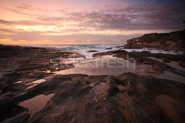 Yena Bay rockshelf low tide at dawn.   Stock photo © lovleah