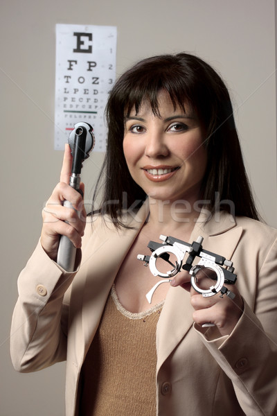 Okulista wyposażenie kobieta lekarza oczy medycznych Zdjęcia stock © lovleah