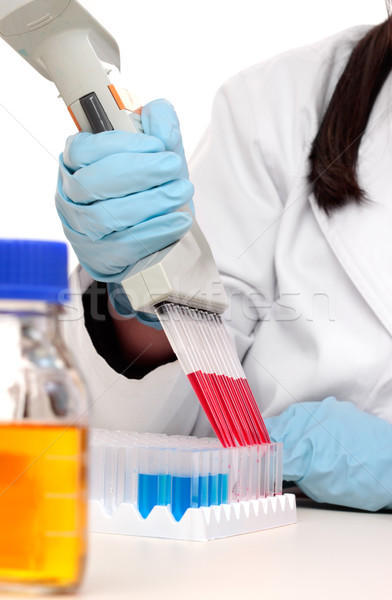 Scientist dispensing liquid from pipette Stock photo © lovleah