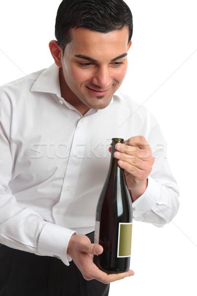 Waiter presenting bottle of wine Stock photo © lovleah