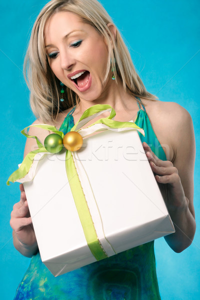 Gift present bring a smile to a woman Stock photo © lovleah