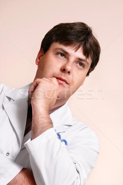 Doctor gazing ahead Stock photo © lovleah