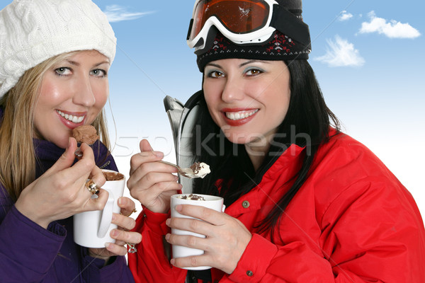 Winter girls enjoy drinks Stock photo © lovleah