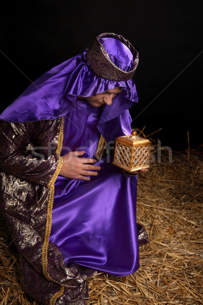 Wise man bowing and holding gift Stock photo © lovleah