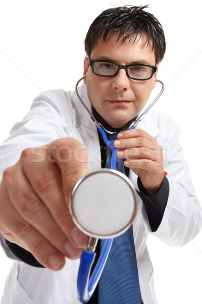 Doctor using stethoscope Stock photo © lovleah