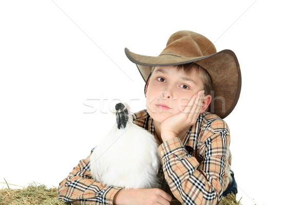 Country or farm boy with farm animal with copyspace Stock photo © lovleah