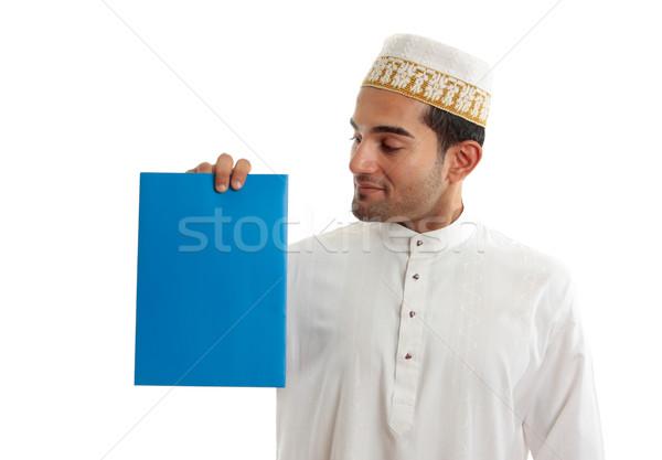Ethnic businessman holding brochure Stock photo © lovleah