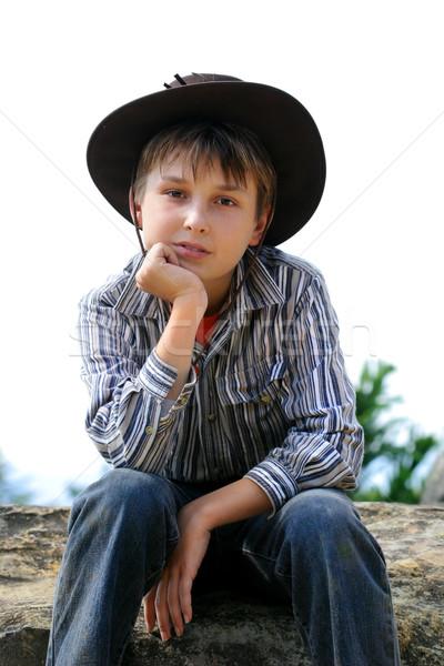 Criança sessão rocha pensando rural menino Foto stock © lovleah
