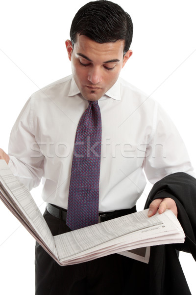 Businessman reading stocks and shares prices in newspaper Stock photo © lovleah